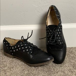 Black with white heart saddle shoes